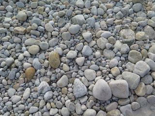 Worn smooth grey rocks along the seashore