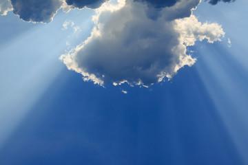 light rays of god on clear blue sky