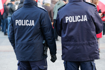 Policemans on the city street, back view