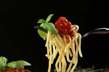 spaghetti bolognese - italien food concept with tomato, basil and spaghetti noodles