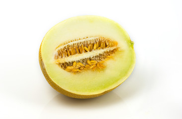 Yellow melon sliced on white background