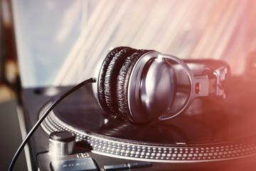 Dj headphones on turntable vinyl record player
