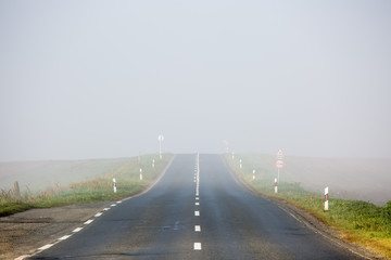 Empty long highway with fog