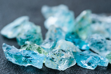 Collection of lovely blue uncut aquamarine gemstones.