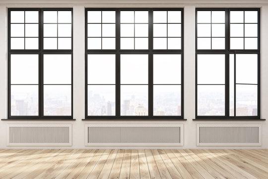 Empty room with big windows and wood floor