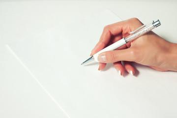 Glamorous woman writes