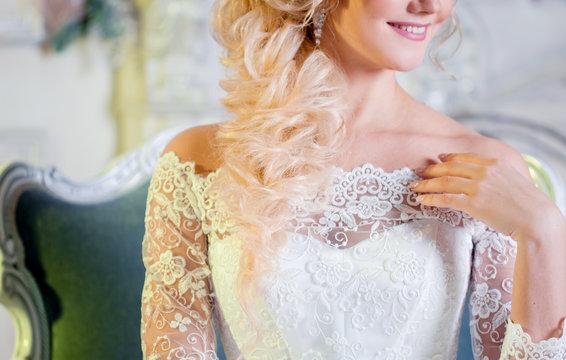 Portrait of charming woman in wedding dress. Closeup of neckline.