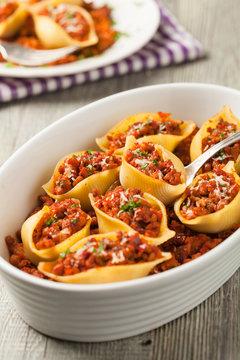 Italian pasta Conchiglioni Rigati stuffed with dry tomatoes and