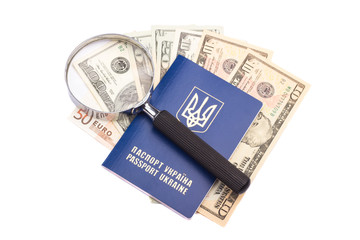 Passport, money and magnifying glass