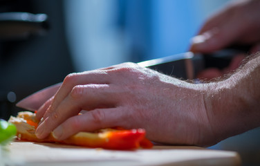 Man cutting vegetables, close-up