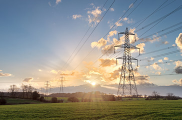 Electricity Pylon - UK standard overhead power line transmission tower at sunset. Wall mural