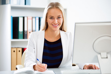 Young business woman with computer