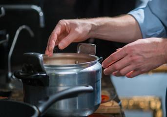 human hands near the pan