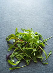 light salad of leaves of mangold ruccola spinach on stone