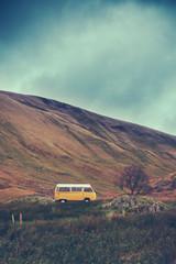 Vintage Camper Van In The Wilderness