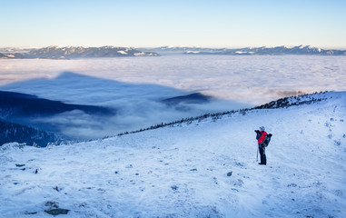 Snow lanscape at the top of a mountain. Sunrise