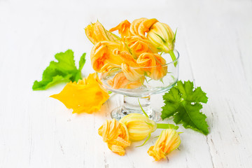 Edible  zucchini flowers on white background