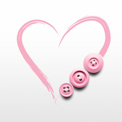 Sewing hard / Creative valentines concept photo of buttons and illustrated heart on white background.