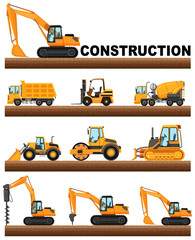 Different types of construction trucks on the ground