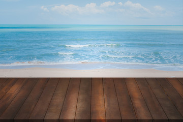 montage of old wood shelf on blurry blue sea background.