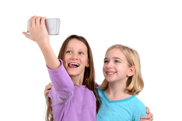 two girls taking a selfie white background