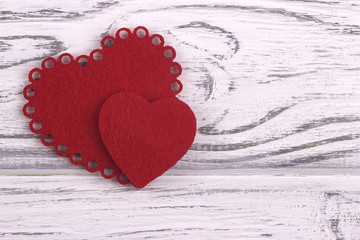 Two Hearts on a white wooden background