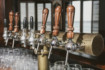 Draft beer taps in modern bar