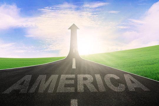 America word on road with arrow upward