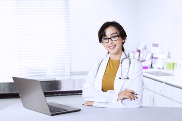 Beautiful doctor looks confident in clinic