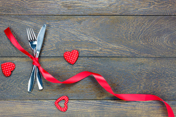 Top view valentines day.dinner set fork and knife,red ribbon.