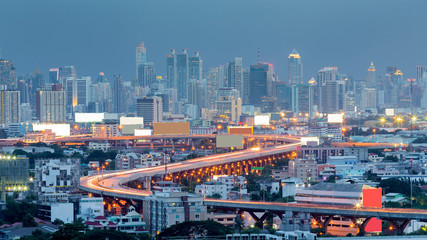 Bangkok city highway curved with central business background, Thailand at twilight