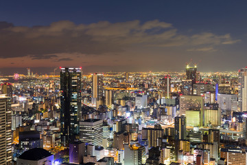 Osaka city business downtown at night view from Umeda sky building, Japan