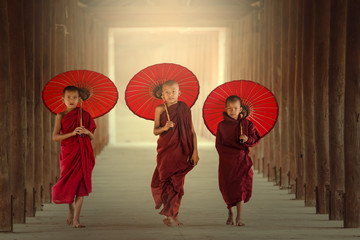 Burmaese Three novice monks walking