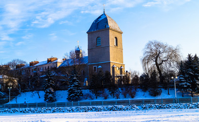 beautiful old Church on the background of blue sky in winter