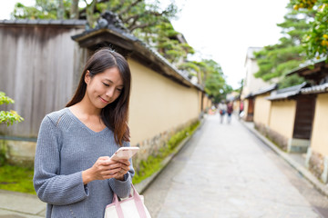 Japanese Woman using cellphone
