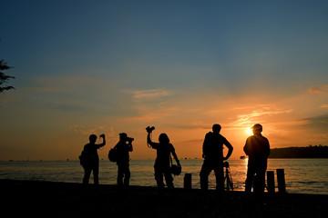 silhouette cameraman