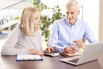 Monthly budget. Shot of a senior couple sitting at home and manage their finances online.
