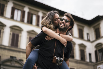 Young couple in love visiting the city of Florence in Italy