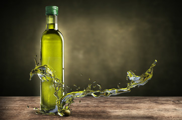 bottle of olive oil with splashes