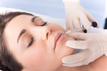 Closeup of beautiful woman receiving hyaluronic acid treatment.