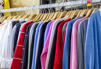 Women colorful blouse in row for sale at the department stores