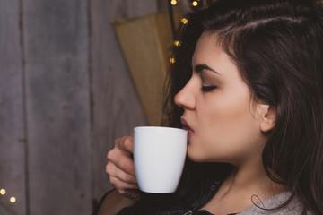Woman enjoying hot drink at home