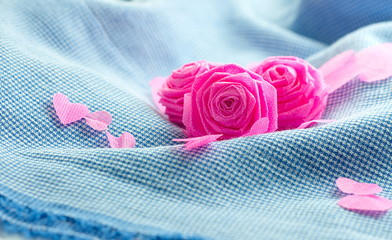Pink rose and small hart on blue cloth background for Valentine