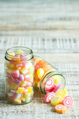 colorful fruit jelly candy on wooden