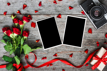 blank photo frames, vintage retro camera and red roses flowers