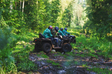 Summer Activities for adults - a trip on quad bikes on the dirty road.