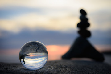 Crystal ball on seashore