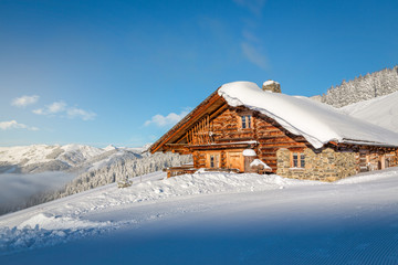 Wooden mountain chalet in the alps in winter