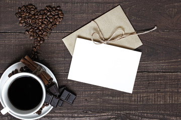 coffee cup and heart shaped beans with blank greeting card