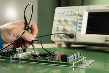 Testing electronic devices with oscilloscope